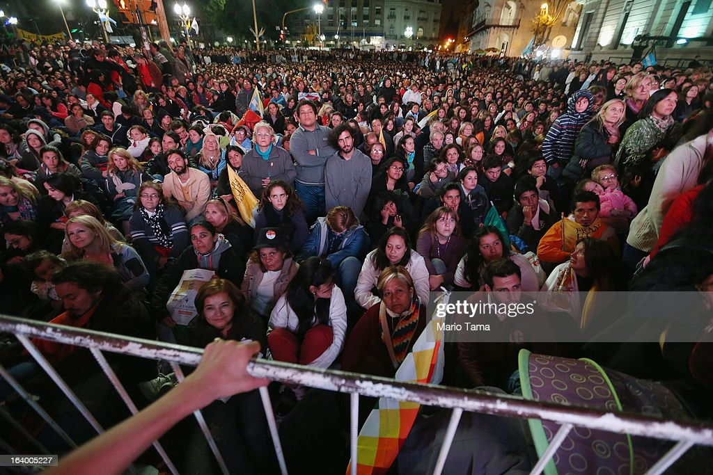 Argentinians gather in Plaza de Mayo while watching a live broadcast of the installation of Pope Francis in Saint Peter's Square on March 19, 2013 in Buenos Aires, Argentina. Francis was the archbishop of Buenos Aires and is the first Pope to hail from Latin America. Celebrants watched in the early morning hours as the event was broadcast at 6:00 a.m. Buenos Aires time.