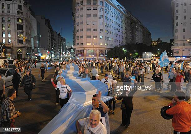 Argentinians protest with a giant national flag near the Obelisk in Buenos Aires against the government of Argentine President Cristina Fernandez de...