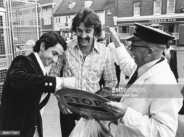Argentnian World Cup winning football players Osvaldo Ardiles and Ricardo Villa sign their autographs on the lollipop sign of a local 'lollipop man'...