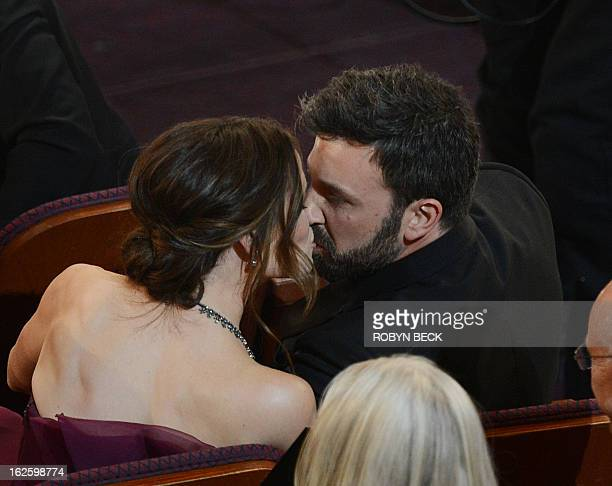 Argo director Ben Affleck kisses his wife actress Jennifer Garner after winning the Oscar for Best Movie at the 85th Annual Academy Awards on...