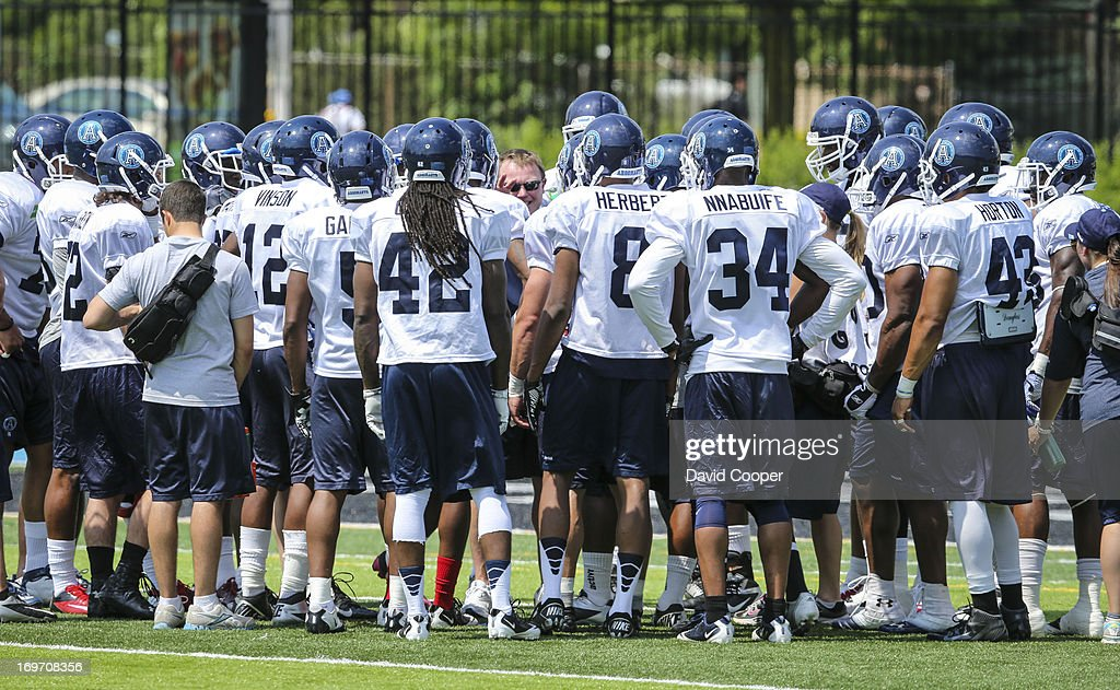 Argos Defensive Coordinator Chris Jones (centre) talks with his charges during the 2nd day of Argos rookie camp at St. Thomas Aquinas High School field.