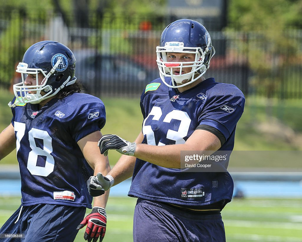 Argos Offensive Lineman Josh Prinsen (63) does running drills during the 2nd day of Argos rookie camp at St. Thomas Aquinas High School field.