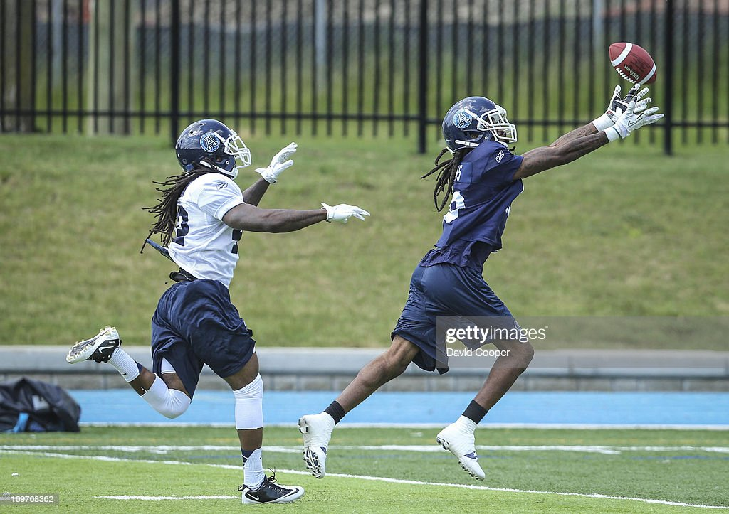 Argos receiver Darvin Adams (10) reaches for the ball as Defensive Back Josh Gatlin (42) tries to stop him during the 2nd day of Argos rookie camp at St. Thomas Aquinas High School field.
