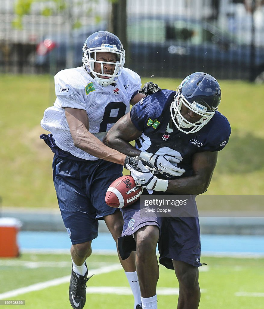 Argos receiver Mike Williams (86) tries to hang on to the ball as Defensive Back Shane Herbert (8) tries to stop him during the 2nd day of Argos rookie camp at St. Thomas Aquinas High School field.