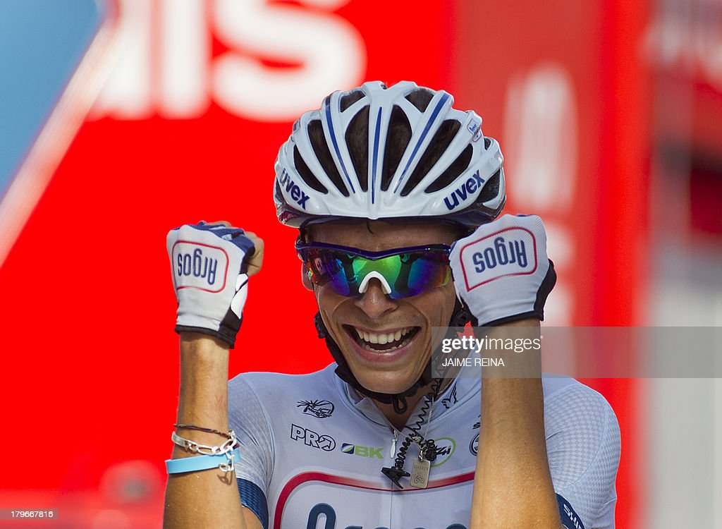 Argos - Shimano's French rider Warren Barguil celebrates winning as he crosses the finish line on September 6, 2013 after the thirteenfth day of the 68th edition of 'La Vuelta' Tour of Spain, a 169km stage between Valls and Castelldefels.