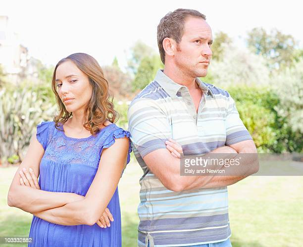 Arguing couple standing outdoors