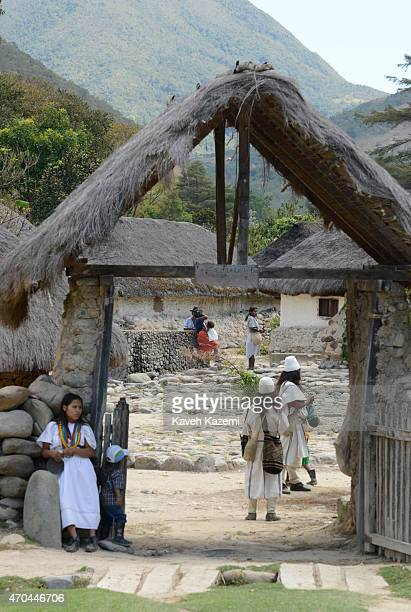 Arhuaco people seen at the entrance of the walled village on January 24 2015 in Nabusimake Colombia Nabusimake is the spiritual center of the Arhuaco...