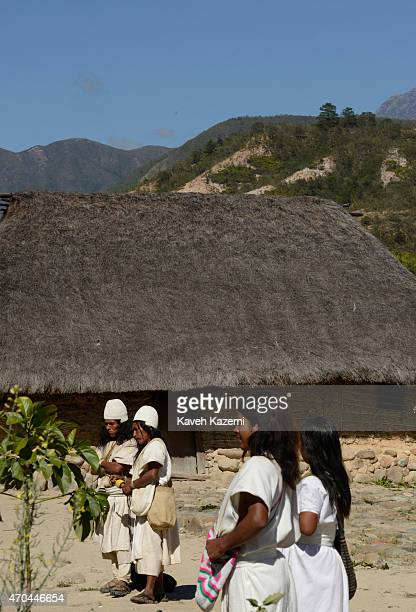 Arhuaco people seen inside the walled village also known as pueblito on January 24 2015 in Nabusimake Colombia The Sierra Nevada hills are seen in...