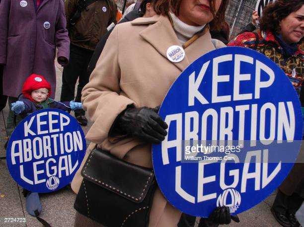 Ari Abbott 1yearsold of Philadelphia and Kathy Black President of Coalition of Labor Union Women holds up a sign during a prochoice rally at Love...