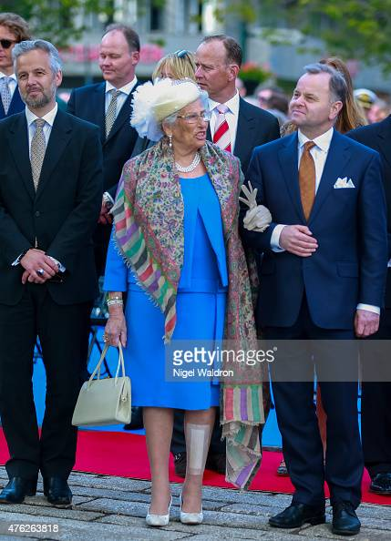 Ari Mikael Behn of Norway Princess Astrid of Norway Olemic Thommessen of Norway attend the unveiling of a statue of King Olav V at the City Hall...