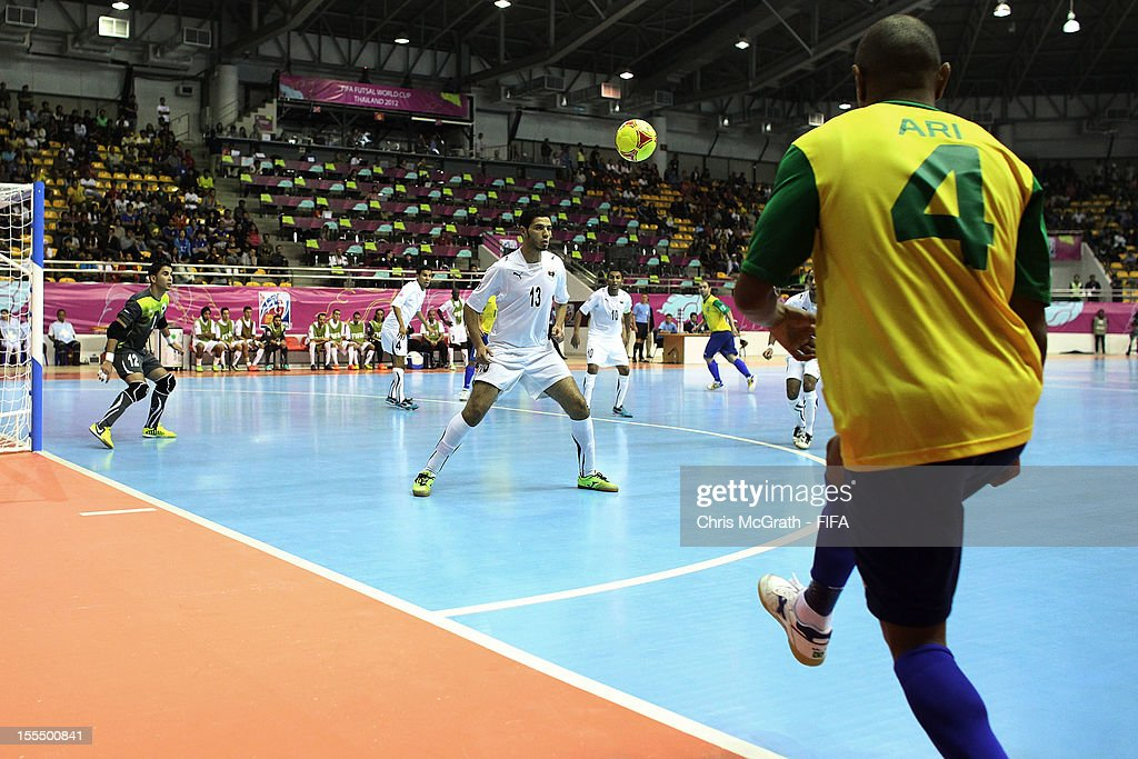 Ari #4 of Brazil kicks the ball into play against Libya during the FIFA Futsal World Cup, Group C match between Brazil and Libya at Korat Chatchai Hall on November 4, 2012 in Nakhon Ratchasima, Thailand.