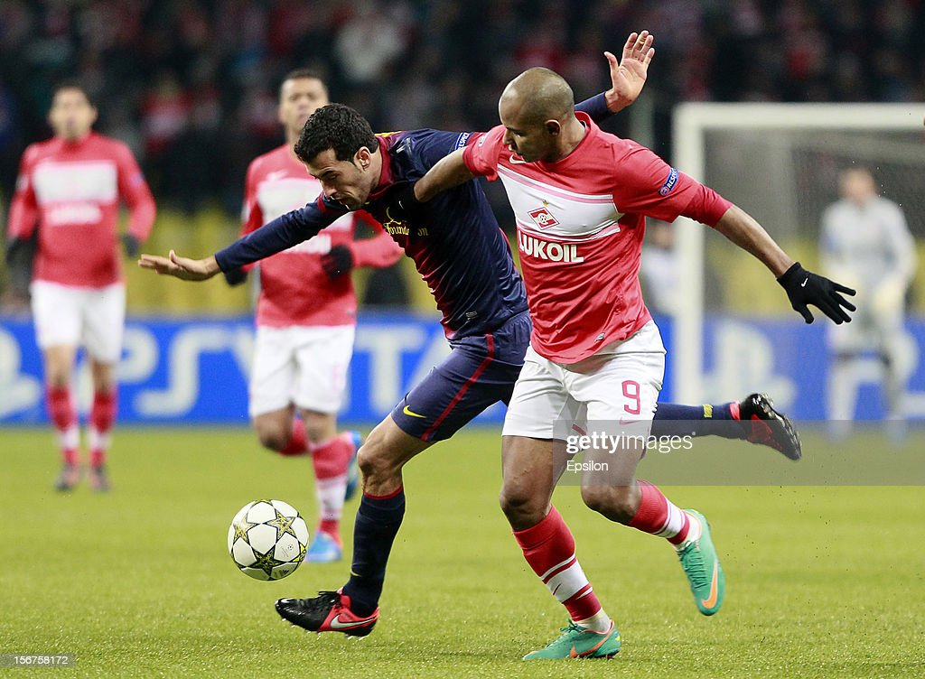 Ari (R) of FC Spartak Moscow battles for the ball with <a gi-track='captionPersonalityLinkClicked' href=/galleries/search?phrase=Sergio+Busquets&family=editorial&specificpeople=5477015 ng-click='$event.stopPropagation()'>Sergio Busquets</a> of FC Barcelona during the UEFA Champions League group G match between FC Spartak Moscow and FC Barcelona at the Luzhniki Stadium on November 20, 2012 in Moscow, Russia.