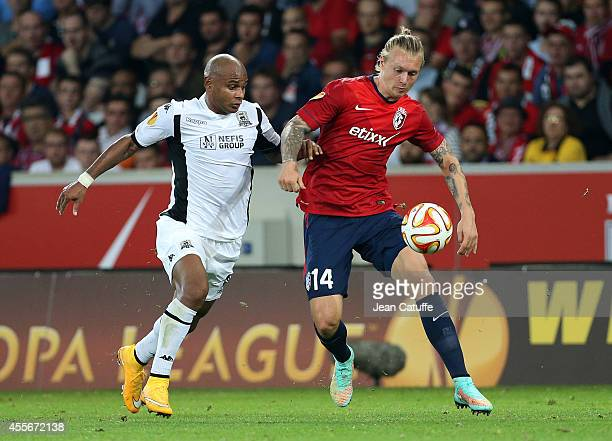 Ari of Krasnodar and Simon Kjaer of Lille challenge for the ball during the UEFA Europa League Group H match between LOSC Lille and FK Krasnodar at...