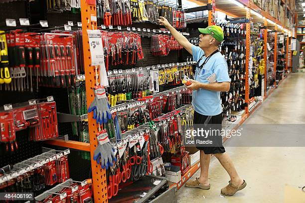 Ari Rodriguez checks out the tools at a Home Depot on August 18 2015 in Miami Florida Today Home Depot shares rose as the company reported...