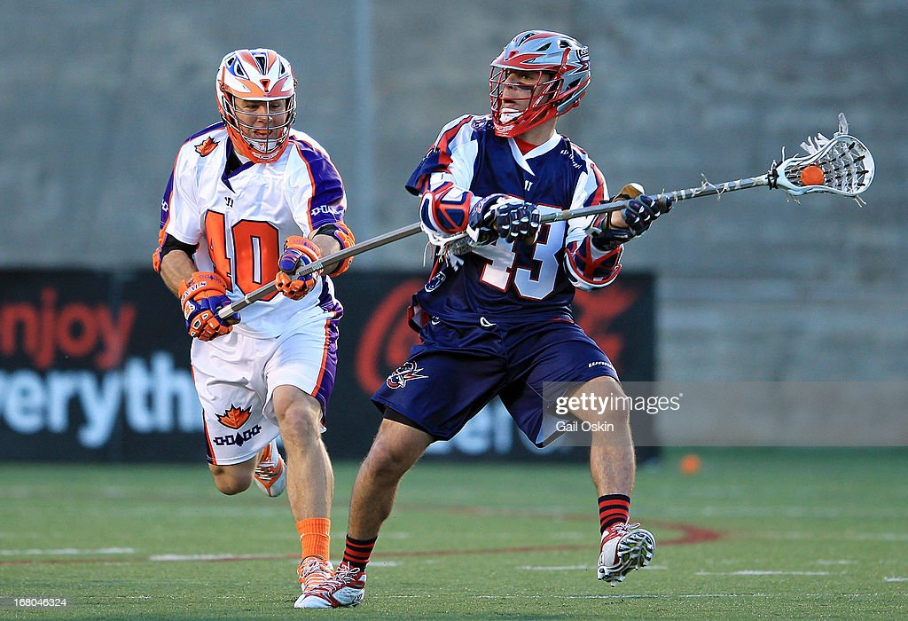 Ari Sussman #43 of the Boston Cannons gets by Matt Lovejoy #40 from the Hamilton Nationals with the ball at Harvard Stadium May 4, 2013 in Boston, Massachusetts.