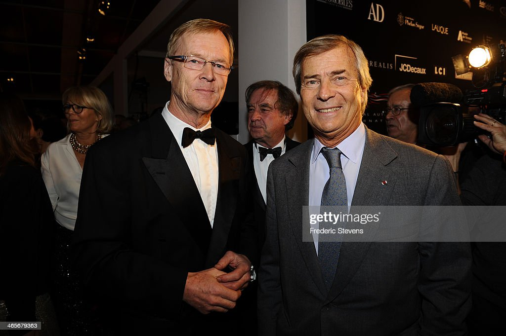Ari Vatanen champion car driver and Vincent Bollore head of groupe Bollore during the 29th International Automobile Festival on January 28, 2014 in Paris, France.