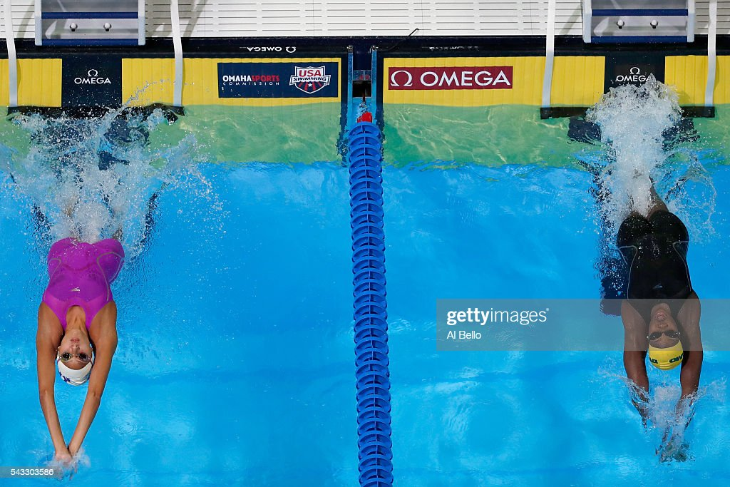 Aria Bernal and Tristen Ulett of the United States compete in a preliminary heat for the Women's 100 Meter Backstroke during Day Two of the 2016 U.S. Olympic Team Swimming Trials at CenturyLink Center on June 27, 2016 in Omaha, Nebraska.