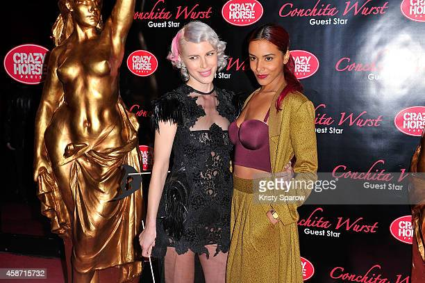 Aria Crescendo and Shy'm attend the Conchita Wurst Crazy Horse Show Premiere at Le Crazy Horse on November 9 2014 in Paris France