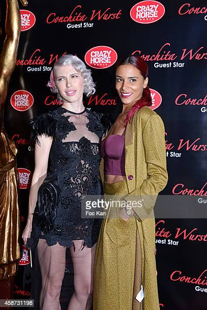 Aria Crescendo and Shy'm attend the Conchita Wurst Crazy Horse Show Red Carpet Arrivals In Paris At the Crazy Horse Saloon on November 9 2014 in...