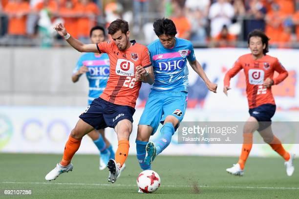 Ariajasuru Hasegawa of Omiya Ardija and Daichi Kamada of Sagan Tosu compete for the ball during the JLeague J1 match between Omiya Ardija and Sagan...