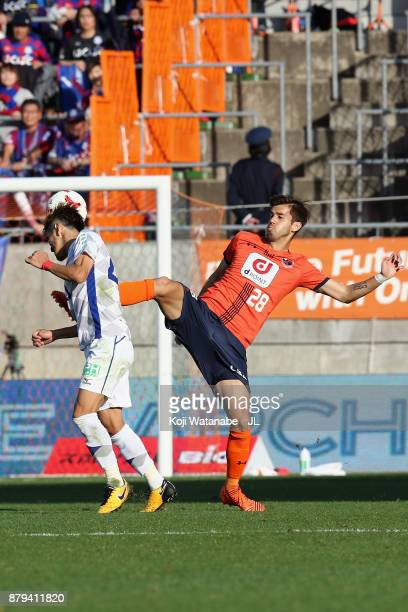 Ariajasuru Hasegawa of Omiya Ardija and Yuta Koide of Ventforet Kofu compete for the ball during the JLeague J1 match between Omiya Ardija and...