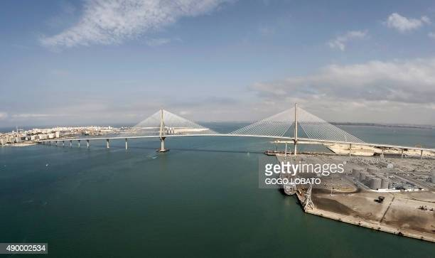 Arial view of the 'La Pepa' bridge or the Constitution of 1812 bridge a suspension construction that crosses the bay of Cadiz is pictured on its...