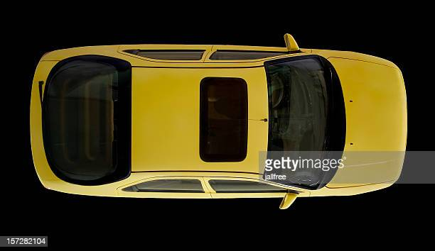 Arial view of yellow car isolated on black