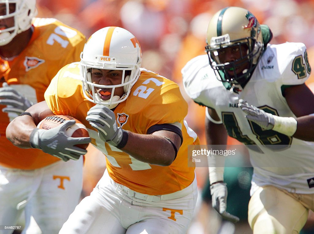 Arian Foster #27 of Tennessee carries the ball as Orlandus King #48 of UAB tries to make the tackle on September 3, 2005 at Neyland Stadium in Knoxville, Tennessee. The Volunteers defeated UAB