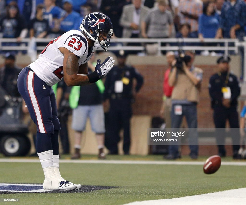 <a gi-track='captionPersonalityLinkClicked' href=/galleries/search?phrase=Arian+Foster&family=editorial&specificpeople=2128663 ng-click='$event.stopPropagation()'>Arian Foster</a> #23 of the Houston Texans celebrates a fourth quarter touchdown while playing the Detroit Lions during a Thanksgiving Day game at Ford Field on November 22, 2012 in Detroit, Michigan. Houston won the game 34-31.