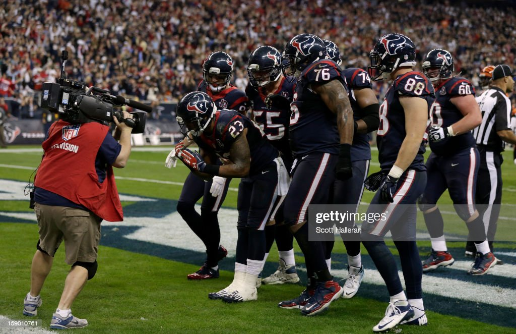 <a gi-track='captionPersonalityLinkClicked' href=/galleries/search?phrase=Arian+Foster&family=editorial&specificpeople=2128663 ng-click='$event.stopPropagation()'>Arian Foster</a> #23 of the Houston Texans celebrates after he scored a 1-yard rushing touchdown in the third quarter against the Cincinnati Bengals during their AFC Wild Card Playoff Game at Reliant Stadium on January 5, 2013 in Houston, Texas.