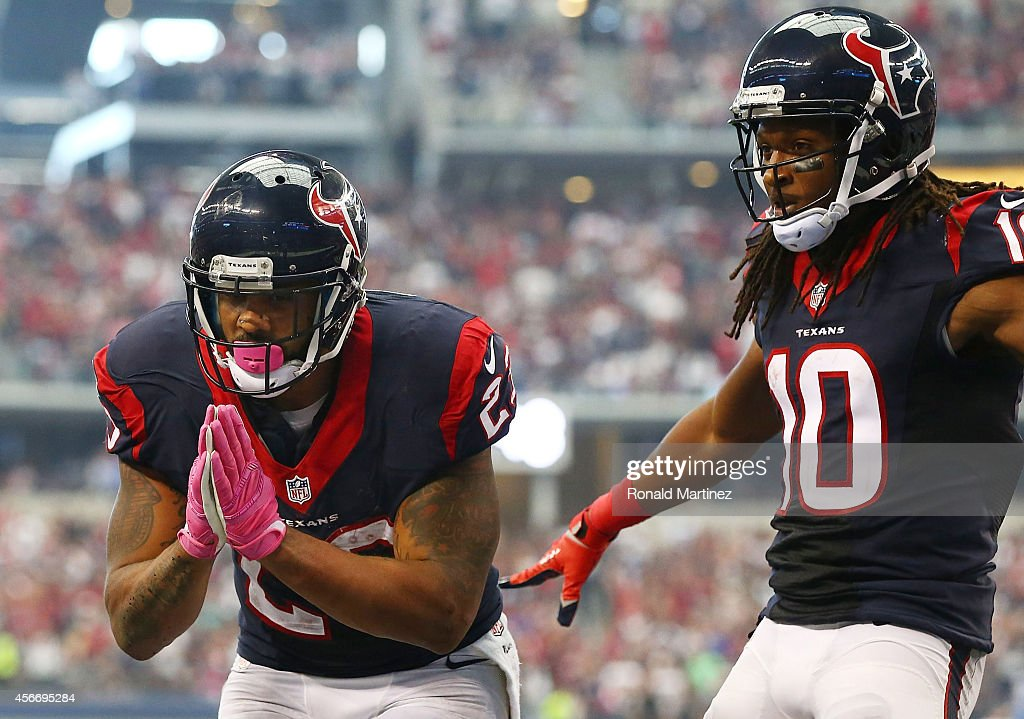 <a gi-track='captionPersonalityLinkClicked' href=/galleries/search?phrase=Arian+Foster&family=editorial&specificpeople=2128663 ng-click='$event.stopPropagation()'>Arian Foster</a> #23 of the Houston Texans celebrates his touchdown to tie the game against the Dallas Cowboys in the second half at AT&T Stadium on October 5, 2014 in Arlington, Texas.