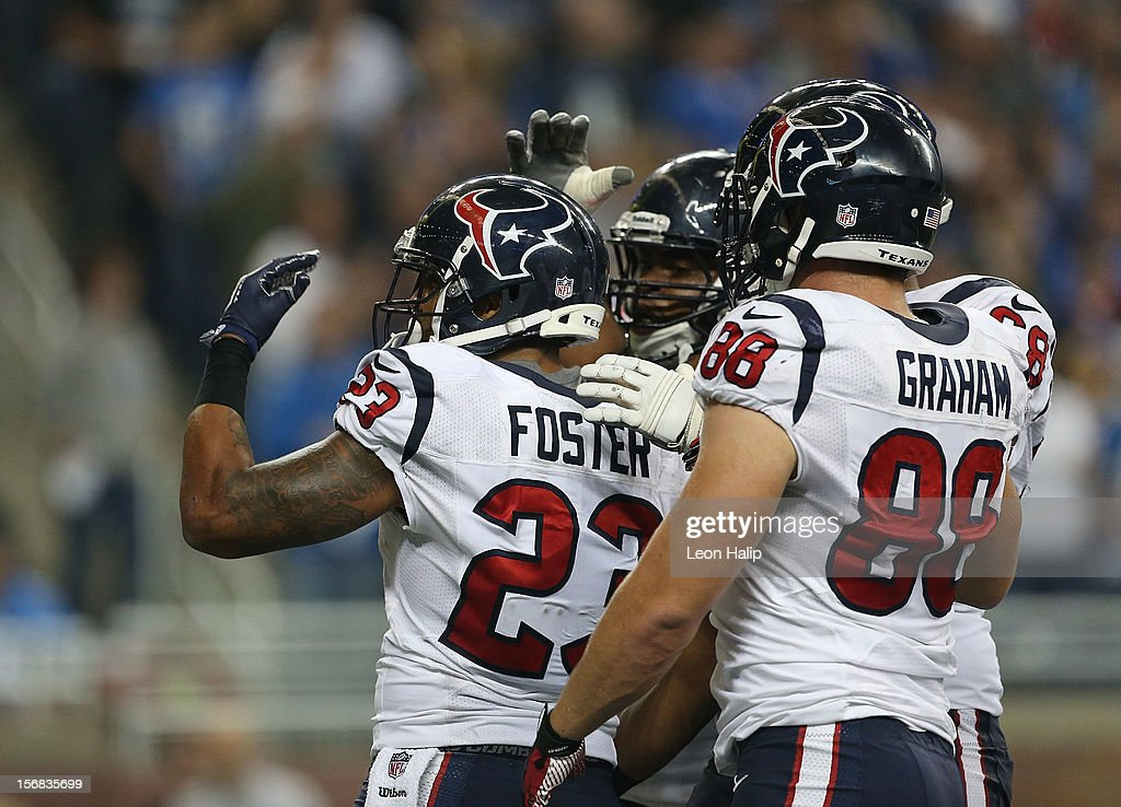 Arian Foster #23 of the Houston Texans celebrates with teammates after scoring on a one yard run in the third quarter during the game against the Detroit Lions at Ford Field on November 22, 2012 in Detroit, Michigan. The Texans defeated the Lions 34-31.