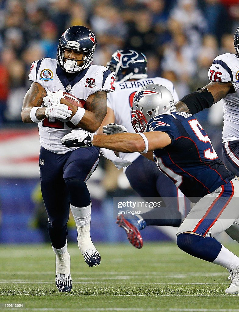 Arian Foster of the Houston Texans is tacked by Rob Ninkovich of the New England Patriots at Gillette Stadium on December 10 2012 in Foxboro...