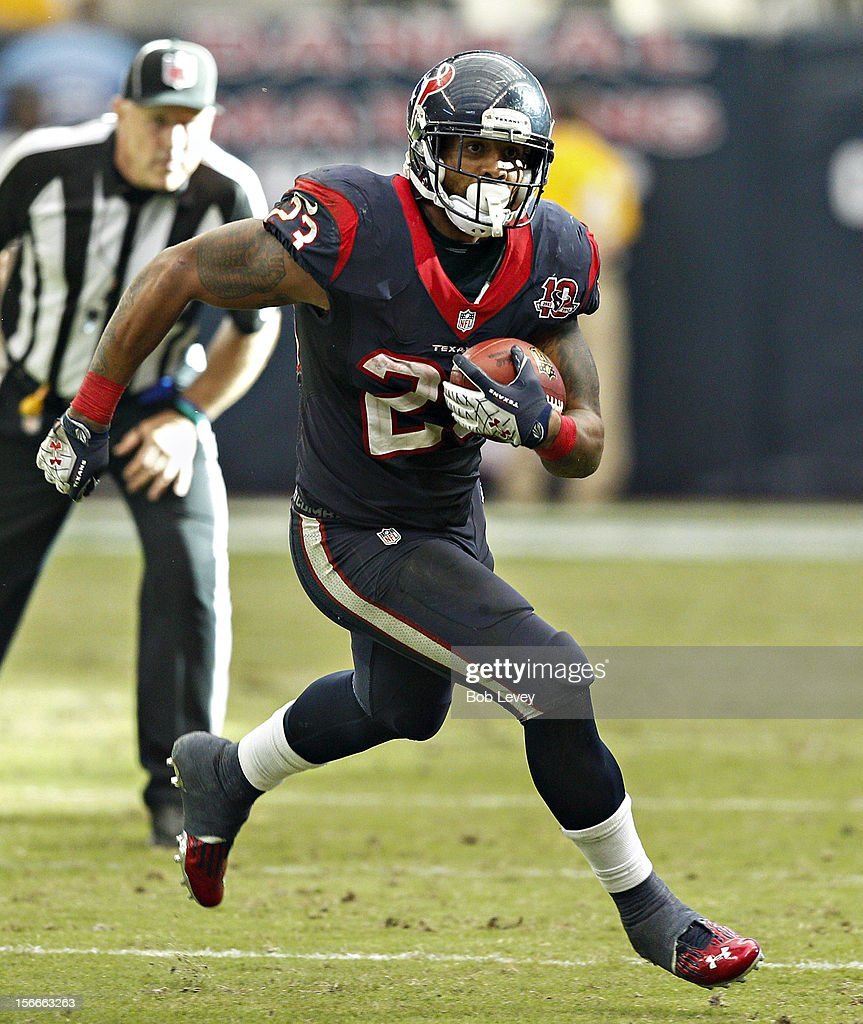 <a gi-track='captionPersonalityLinkClicked' href=/galleries/search?phrase=Arian+Foster&family=editorial&specificpeople=2128663 ng-click='$event.stopPropagation()'>Arian Foster</a> #23 of the Houston Texans looks for room to run against the Jacksonville Jaguars at Reliant Stadium on November 18, 2012 in Houston, Texas. Houston wins 43-37 in overtime.
