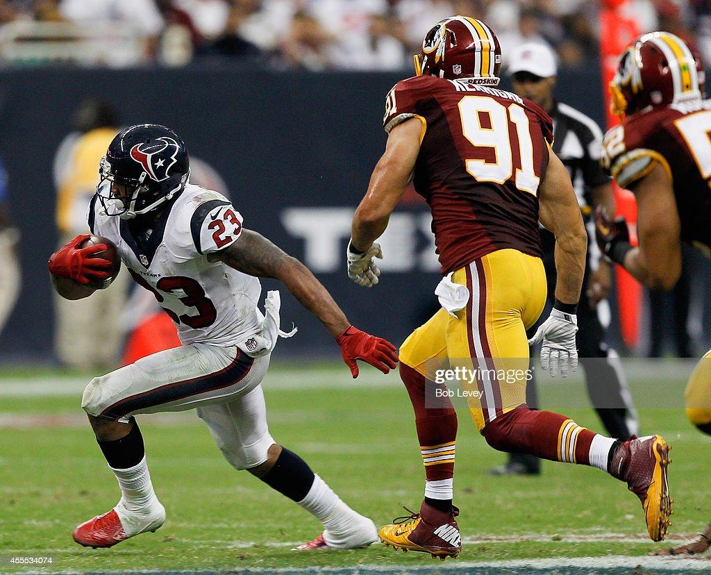 Arian Foster of the Houston Texans runs around Ryan Kerrigan of the Washington Redskins at NRG Stadium on September 7 2014 in Houston Texas