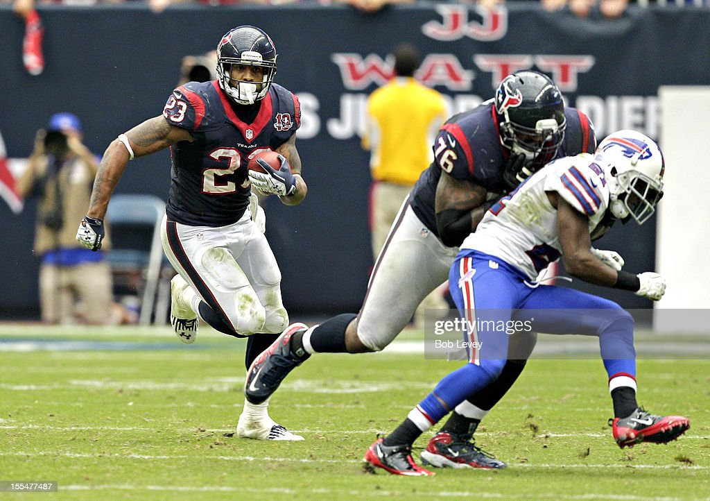 <a gi-track='captionPersonalityLinkClicked' href=/galleries/search?phrase=Arian+Foster&family=editorial&specificpeople=2128663 ng-click='$event.stopPropagation()'>Arian Foster</a> #23 of the Houston Texans rushes to sideline as he gets a block from Duane Brown #76 of the Houston Texans at Reliant Stadium on November 4, 2012 in Houston, Texas. Houston defeated Buffalo 21-9.