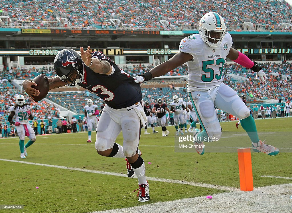 <a gi-track='captionPersonalityLinkClicked' href=/galleries/search?phrase=Arian+Foster&family=editorial&specificpeople=2128663 ng-click='$event.stopPropagation()'>Arian Foster</a> #23 of the Houston Texans scores a touchdown over <a gi-track='captionPersonalityLinkClicked' href=/galleries/search?phrase=Jelani+Jenkins&family=editorial&specificpeople=5653455 ng-click='$event.stopPropagation()'>Jelani Jenkins</a> #53 of the Miami Dolphins during a game at Sun Life Stadium on October 25, 2015 in Miami Gardens, Florida.