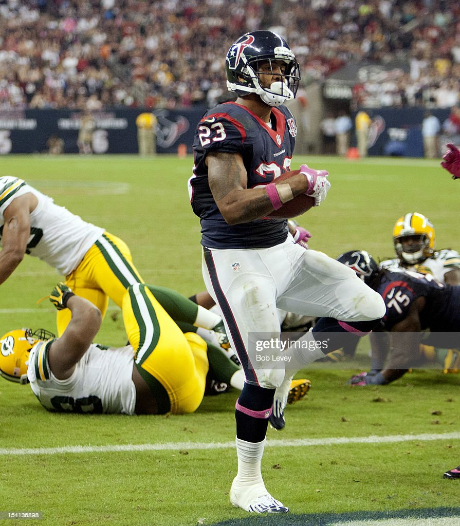 Arian Foster #23 of the Houston Texans scores on a one yard run in the second quarter against the Green Bay Packers at Reliant Stadium on October 14, 2012 in Houston, Texas. Green Bay Packers defeated Houston 42-24.
