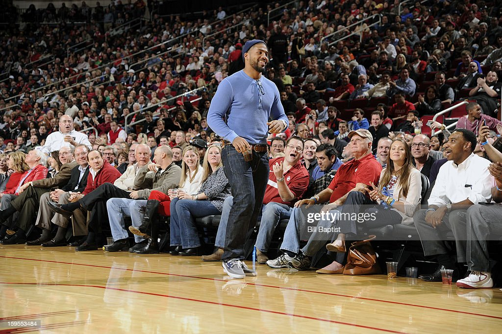 Arian Foster Running Back for the Houston Texans watches the game between the Houston Rockets and the Los Angeles Clippers on January 15, 2013 at the Toyota Center in Houston, Texas.