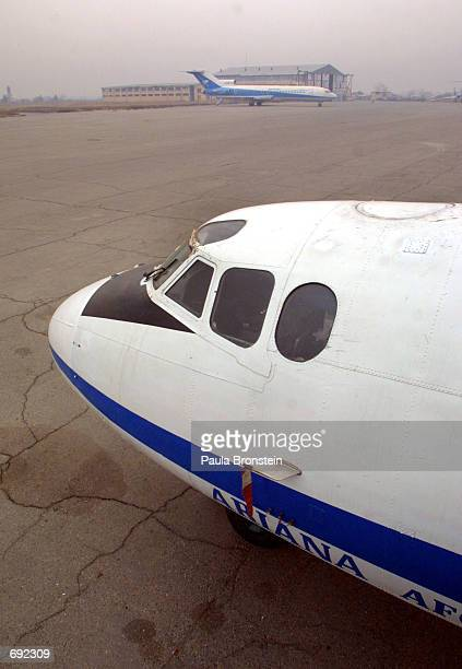 Ariana Afghan Airlines planes sit on the tarmac January 10 2001 at Kabul airport in Afghanistan The airport is in the midst of preparing for...