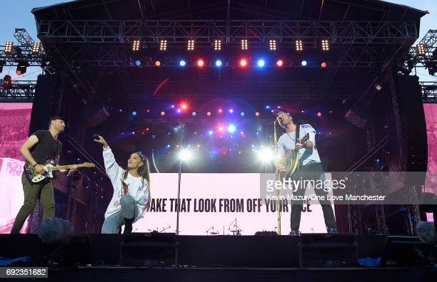 Ariana Grande and Chris Martin and Coldplay perform on stage during the One Love Manchester Benefit Concert at Old Trafford Cricket Ground on June 4...