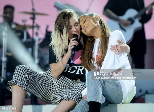 Ariana Grande and Miley Cyrus perform on stage during the One Love Manchester Benefit Concert at Old Trafford Cricket Ground on June 4 2017 in...