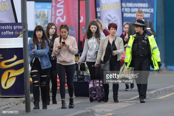 Ariana Grande concert attendees leave the Park Inn Hotel where they were given refuge after last nights explosion at Manchester Arena on May 23 2017...