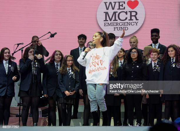 Ariana Grande performs on stage with Parrs Wood High School Choir during the One Love Manchester Benefit Concert at Old Trafford Cricket Ground on...