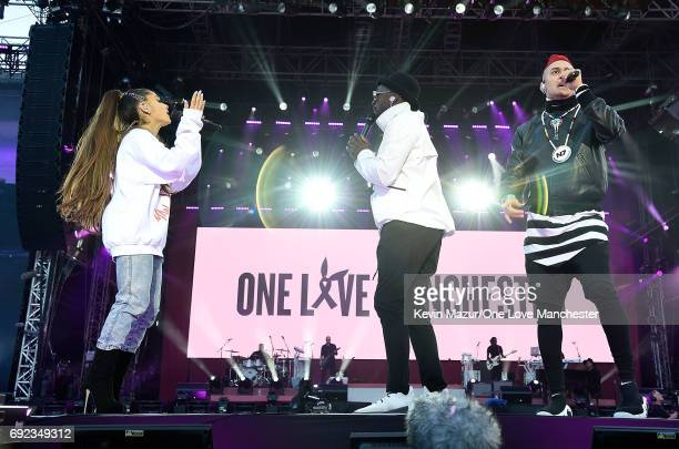 Ariana Grande performs on stage with Taboo and william of The Black Eyed Peas during the One Love Manchester Benefit Concert at Old Trafford Cricket...
