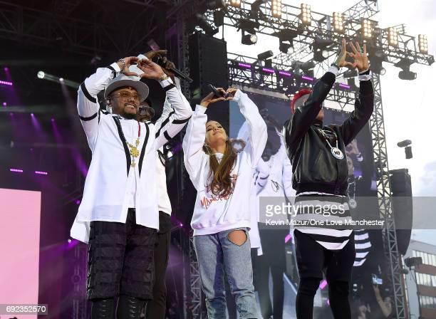 Ariana Grande performs on stage with Taboo apldeap and william of The Black Eyed Peas during the One Love Manchester Benefit Concert at Old Trafford...