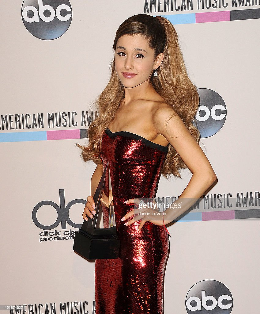 <a gi-track='captionPersonalityLinkClicked' href=/galleries/search?phrase=Ariana+Grande&family=editorial&specificpeople=5586219 ng-click='$event.stopPropagation()'>Ariana Grande</a> poses in the press room at the 2013 American Music Awards at Nokia Theatre L.A. Live on November 24, 2013 in Los Angeles, California.