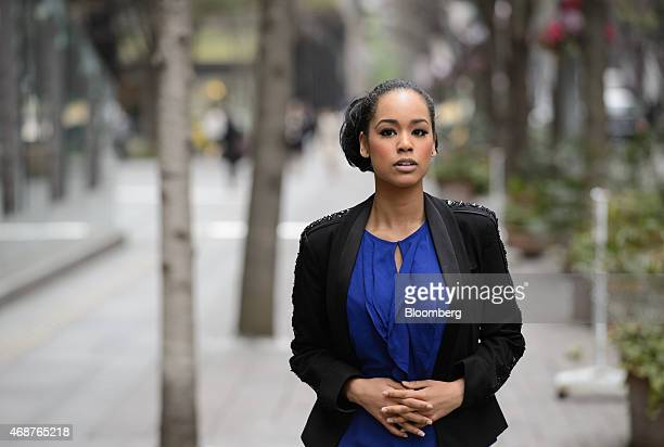 Ariana Miyamoto Miss Universe Japan 2015 poses for a photograph while walking along a street in Tokyo Japan on Friday April 3 2015 Japan's first...