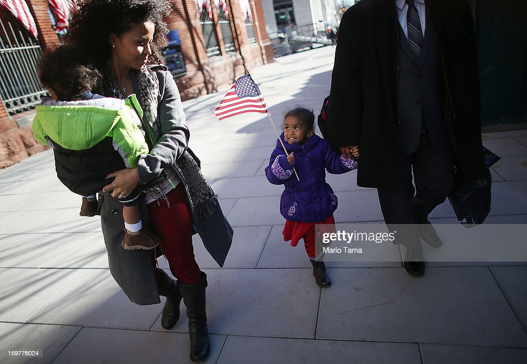 Ariana Smith carries an American flag as mother Ana Blanco-Smith carries Christian Smith as Washington prepares for President Barack Obama's second inauguration on January 20, 2013 in Washington, DC. The family travelled from Florida to attend the inauguration. One day before the public inaugural ceremony at the U.S. Capitol on January 21, Obama was officially sworn in for his second term during a private ceremony surrounded by friends and family in the Blue Room of the White House.