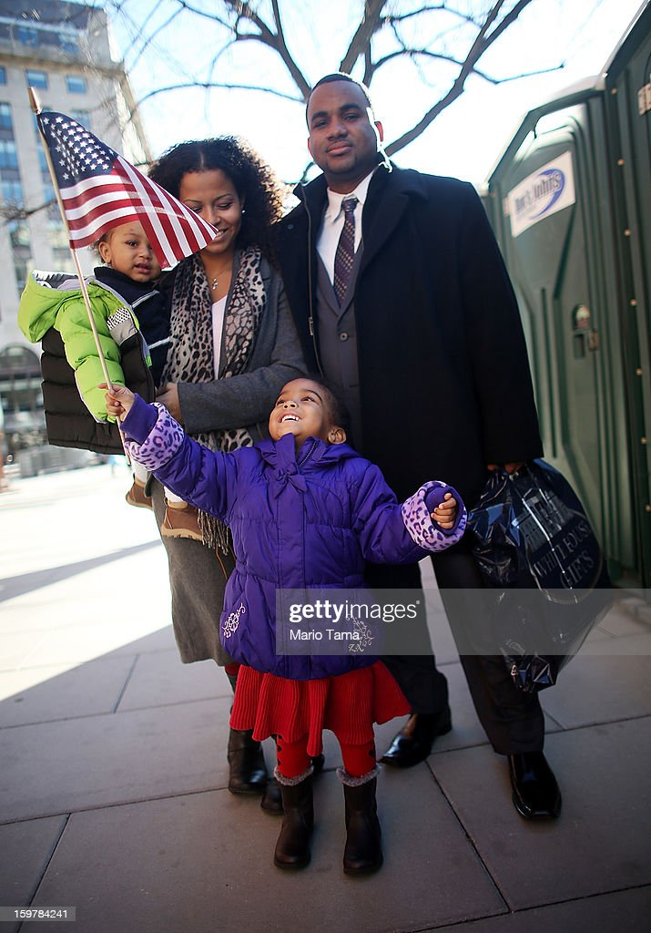Ariana Smith holds an American flag as mother Ana Blanco-Smith carries Christian Smith and father Grasford Smith poses during preparations for U.S. President Barack Obama's second inauguration on January 20, 2013 in Washington, DC. The U.S. capital is preparing for the second inauguration of U.S. President Barack Obama, which will take place on January 21.